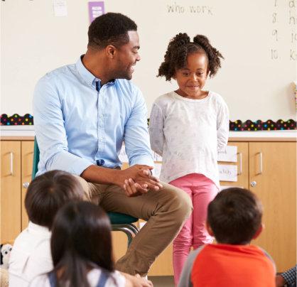 children and teacher talking