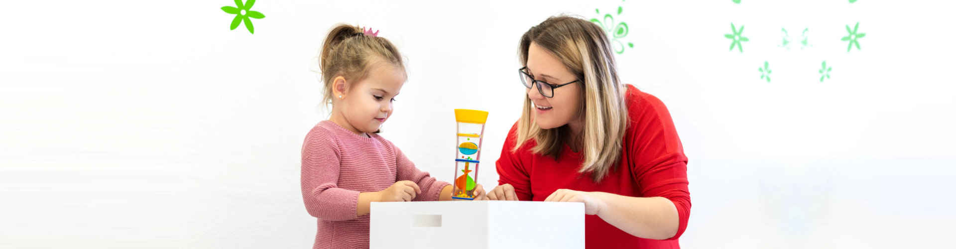 little girl playing toys with teacher